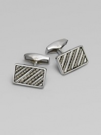 Rectangular sterling silver links are set with hand-twisted wire inlaid within silver bars. Sterling silver About ¼ X ½ Made in the United Kingdom
