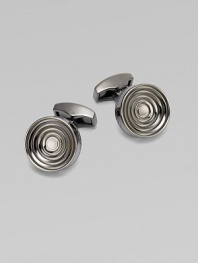 Concentric links of gunmetal-plated metal are polished on the outside and sandblasted in the recessed ridges to enhance the pattern. Gunmetal-plated metal About ½ diam. Made in the United Kingdom