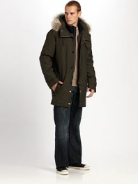 A wonderland of winter cool, complete with removable coyote-fur trim and a quilted interior jacket. Wear the liner with the jacket, without it or on its own. Zip front with button storm flap Side zip pockets About 36 from shoulder to hem Natural coyote fur 93% polyester/7 nylon Dry clean Fur origin: Canada Imported